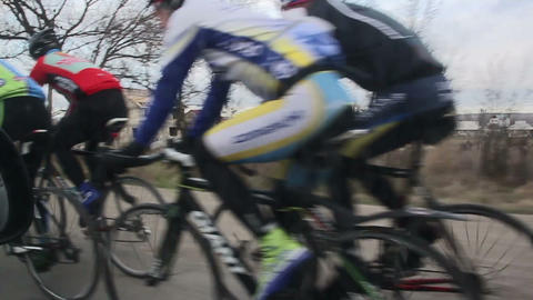 Cyclists on a cloudy day on the road Footage