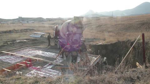 Concrete mixer prepares for unloading Live Action