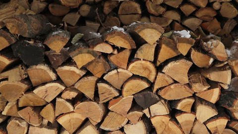 pile of stacked firewood in winter Footage