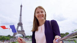 Woman with French flag near Eiffel Tower doing selfie. Smiling tourist woman Footage