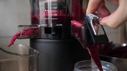 Process of extracting fresh beetroot juice. Slow motion Live Action