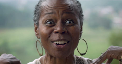 Very excited happy attractive African American woman in her 60s expressing Footage