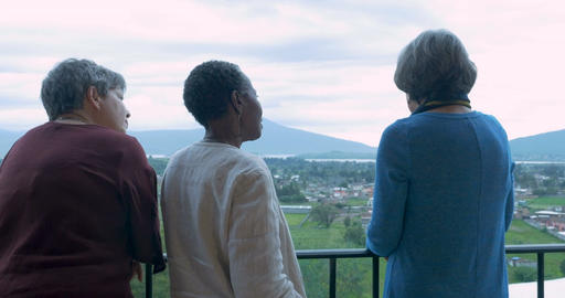 Three older women vacationers in their 60s talking at an scenic overlook Footage