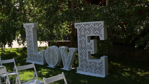 decoration for the wedding ceremony, a huge inscription Love Footage