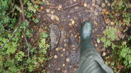 Man in Rain Boots Walking Forest Path in Autumn Rainy Day. 4K, Slowmotion Footage