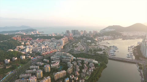 Aerial: Busy Chinese Sanya City Sunset View, China. 4K Footage