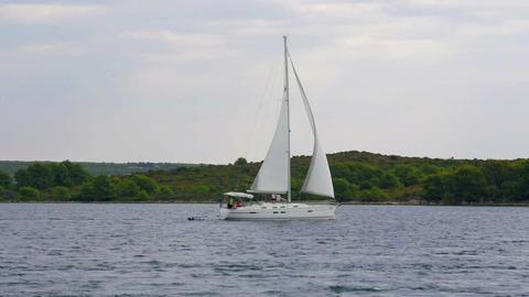 PASMAN, ISLAND PASMAN, CROATIA, 2017.08.22: Sailin boat sailing by town Pasman Footage