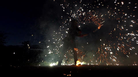 Juggler Turns Two Bengal Fire Sparklers. They Throw Around Hundreds of Sparkles Footage