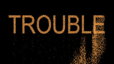 text TROUBLE appears from the sand, then crumbles. Alpha channel Premultiplied - Animation