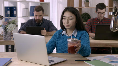 Woman working with documents and laptop in office Footage