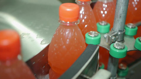 Filling lemonade in plastic bottles. Lemonade bottle label industry conveyor Footage