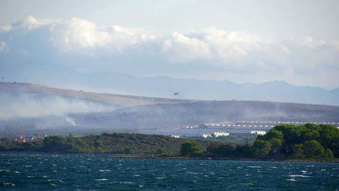 Forest fire with lots of smoke at Croatian coastline next to the town of Footage