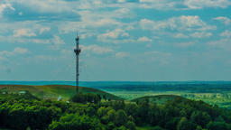 Telecommunications tower communications on a background of sky clouds Footage