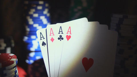 Four Aces On Poker Chips. Poker Table With Chips In Casino Footage