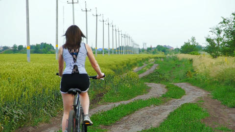 brunette girl rides a bicycle Footage