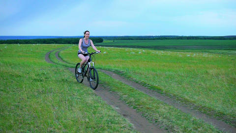 Girl With Bicycle, Young woman with bicycle in a wheat field Footage
