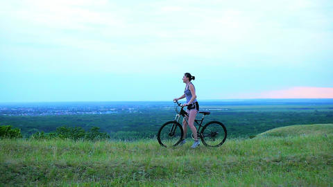 Free Happy Woman Riding Bicycle at Sunset Summer Field Footage