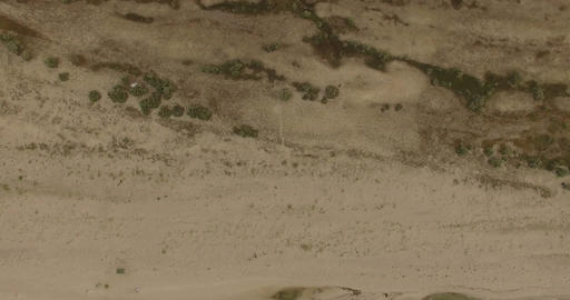 4k aerial - Aerial Shot of a Sandy Beach With Patches of Greenery Footage