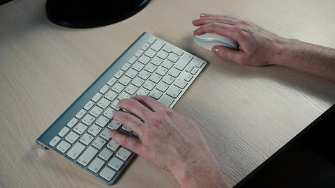 woman typing on computer keyboard Footage