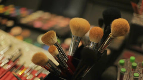 Professional cosmetics in the salon of a make-up artist. cosmetic brushes close Footage