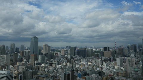 High angle timelapse of skyscrapers and cloudscape over Tokyo Footage