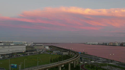 High angle timelapse of colorful cloudscape over Haneda Airport Footage