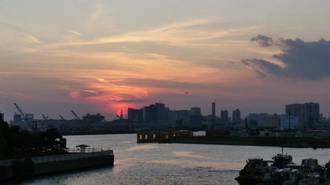 Sunset timelapse over the Tokyo Bay and waterfront buildings Footage