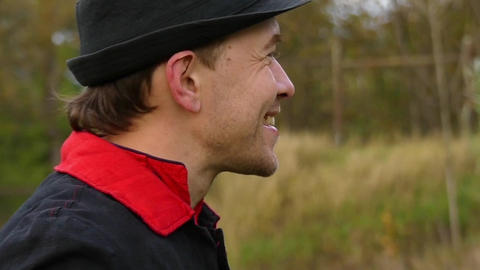Young Man in a Black Hat Stands in a Forest, Shows a Thumb up Gesture in Slo-Mo Footage