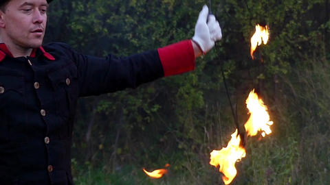 Juggler Turns Two Metal Fans With Flame Around Himself in Slo-Mo. it is Magic Footage