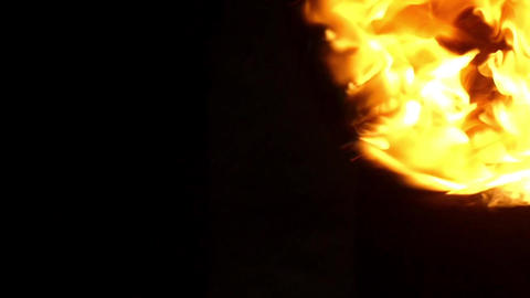 Two Lit Balls of Fire Swing Right And Left in Autumn at Night in Slow Motion Footage