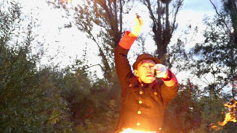 Juggler Turns Two Balls of Fire Above His Head in a Forest in Slow Motion Footage