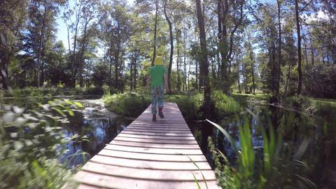 Child walking on footbridge Footage