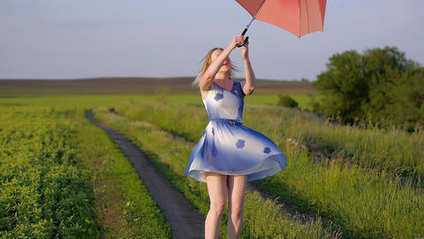 portrait of a beautiful girl with a red umbrella in the sunset smiling emotions Live Action
