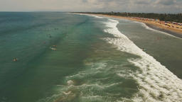 Aerial view beautiful beach with surfers, Bali, Kuta Footage
