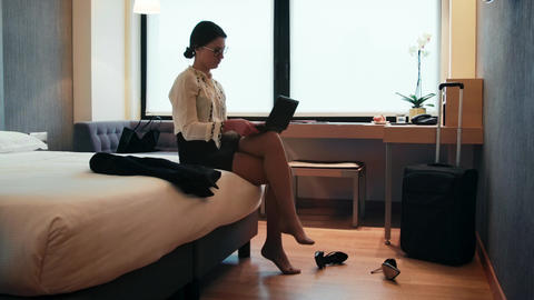 Woman Taking Shoes Off Businesswoman In Hotel Room During Trip Live Action