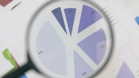 Magnifying glass is considering rotating blue diagram Live Action