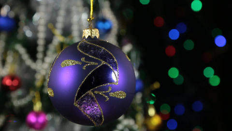Beautiful blue New Year and Christmas decoration ball swinging on rope Footage
