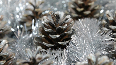 Close-up of the rotation of silver tinsel and silver pine cones. The light is Footage