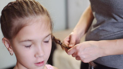 The woman he plaits braid her daughter Footage
