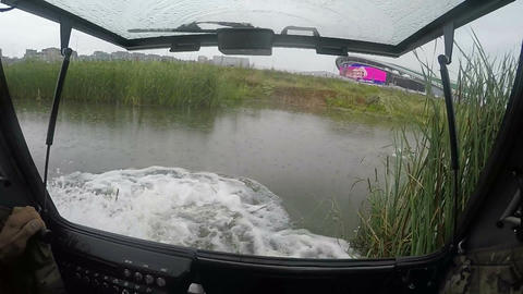 Slow Motion View from Hovercraft Cabin on Lake and Stadium Footage
