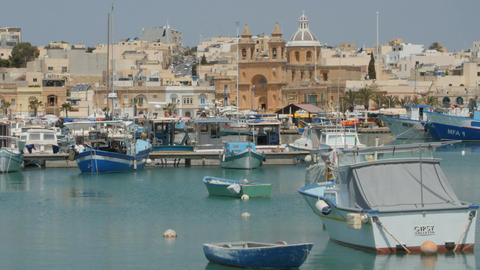 MARSAXLOKK, MALTA - July 6, 2016: Beautiful fishing village architecture with Footage