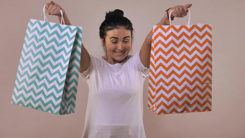 cheerful female shows shopping bag Footage