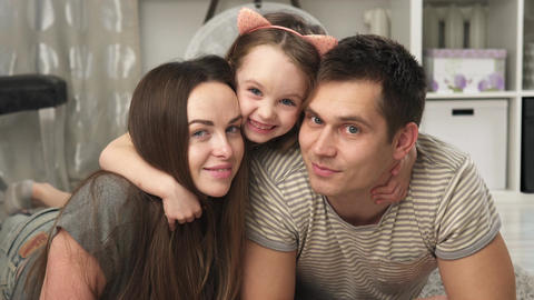 mother, father and little daughter smiling Footage