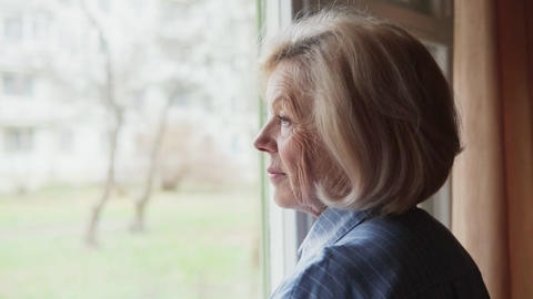 old woman looking out the window Footage