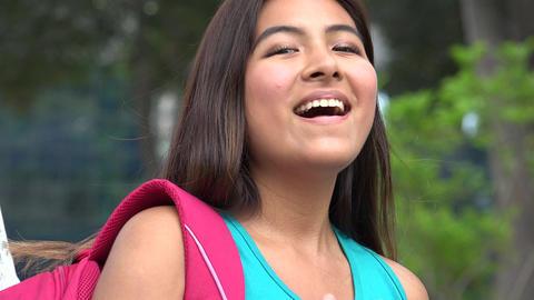 Laughing Hispanic Female Teen Student 画像