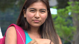 Unhappy Female Hispanic Teen Student Live Action