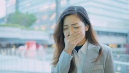 business woman coughing and sneezing at outdoor in the city Footage