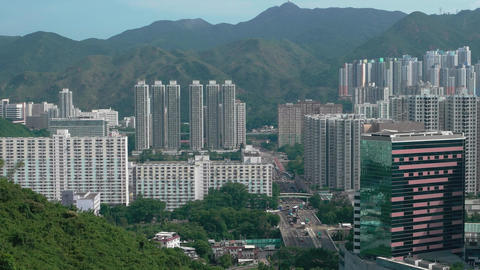 Hong Kong - View of tower blocks and traffic in streets of Sha Tin District of ビデオ