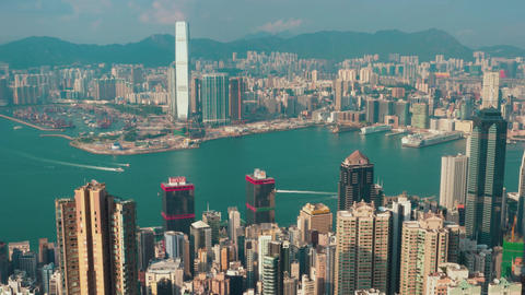 Hong Kong - Elevated view of Victoria Harbour with boat traffic and skyscrapers Footage