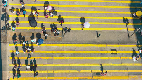 Hong Kong - Aerial top view of people and traffic on crosswalk at Tsim Sha Tsui. Footage
